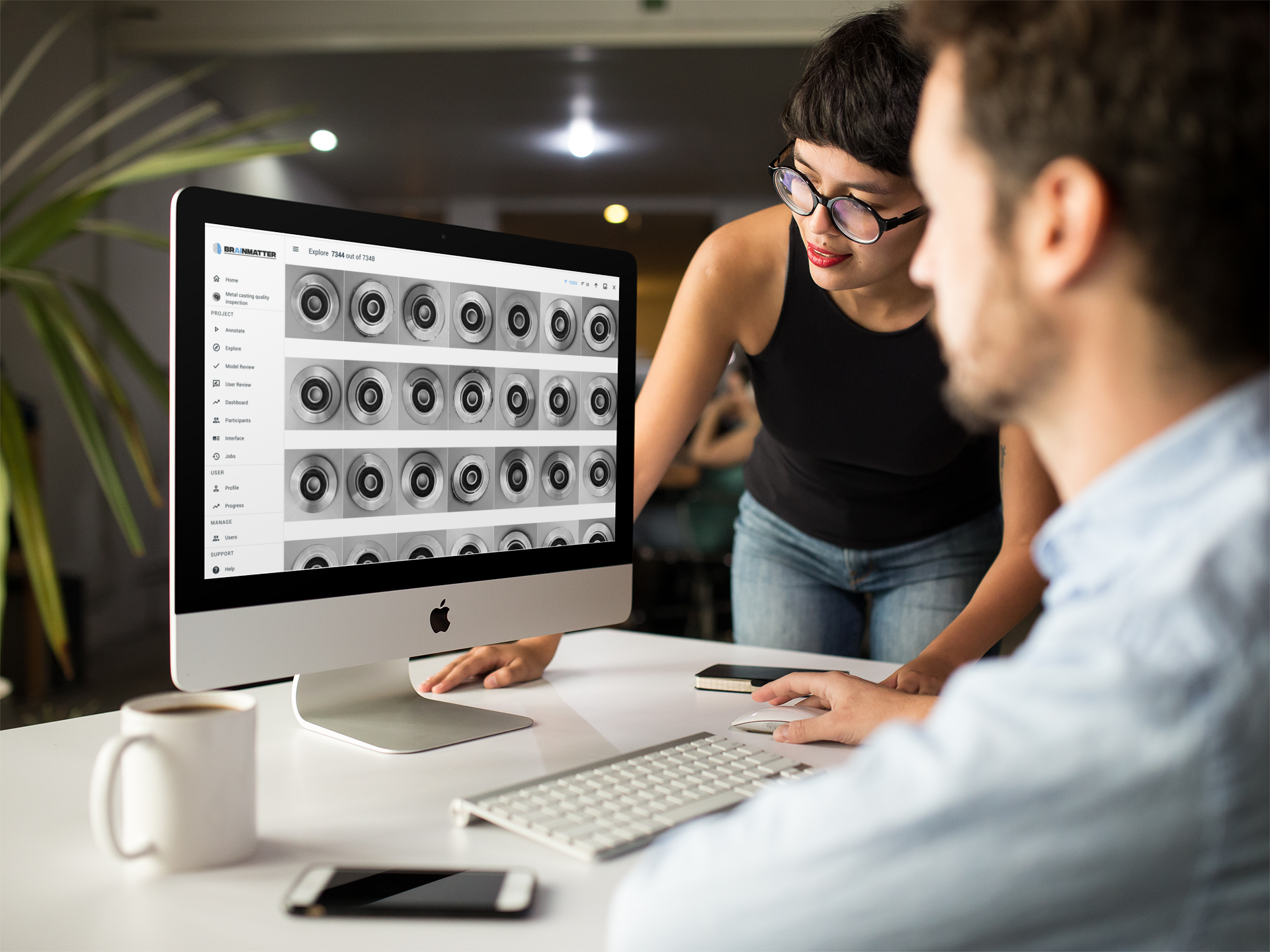girl-showing-something-in-imac-mockup-to-coworker-a16266 (2)