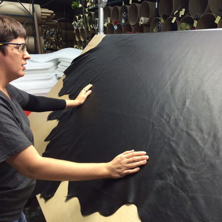person inspecting leather